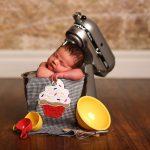 baby sleeping in kitchen mixer