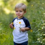 little boy holding flowers