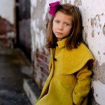 little girl in yellow jacket