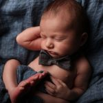 baby sleeping with bow tie on