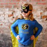 little girl in super hero costume